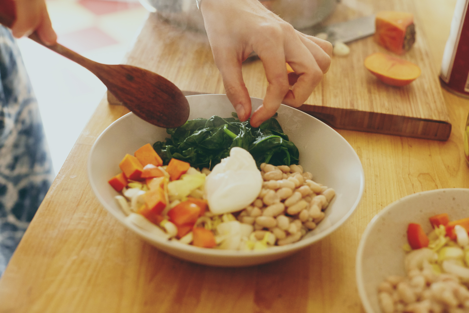 Ashley Neese Nutritional Counsellor prepares her Winter Wellness bowl with leafy greens for Foodadit in Los Angeles