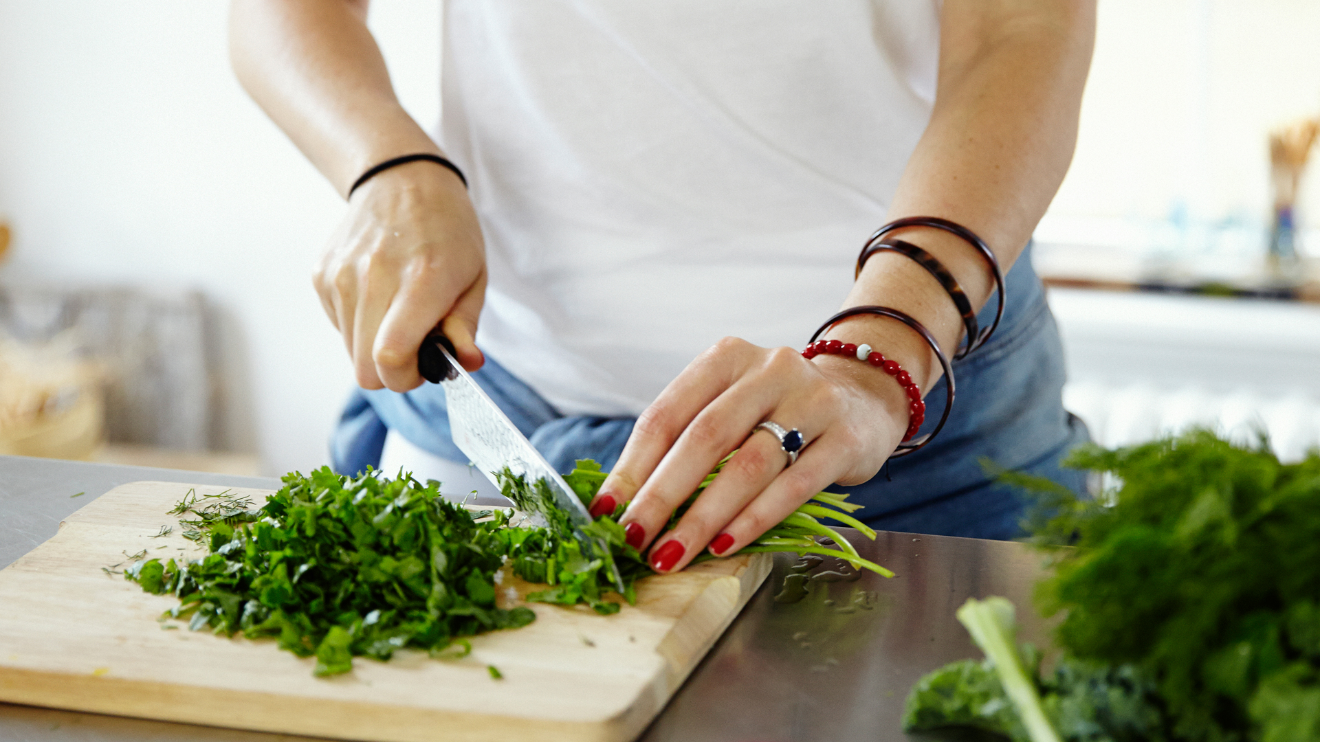 catherine-cuello-chopping-herbs-for-her-recipe-for-french-lentils-with-a-ton-of-herbs-foodadit