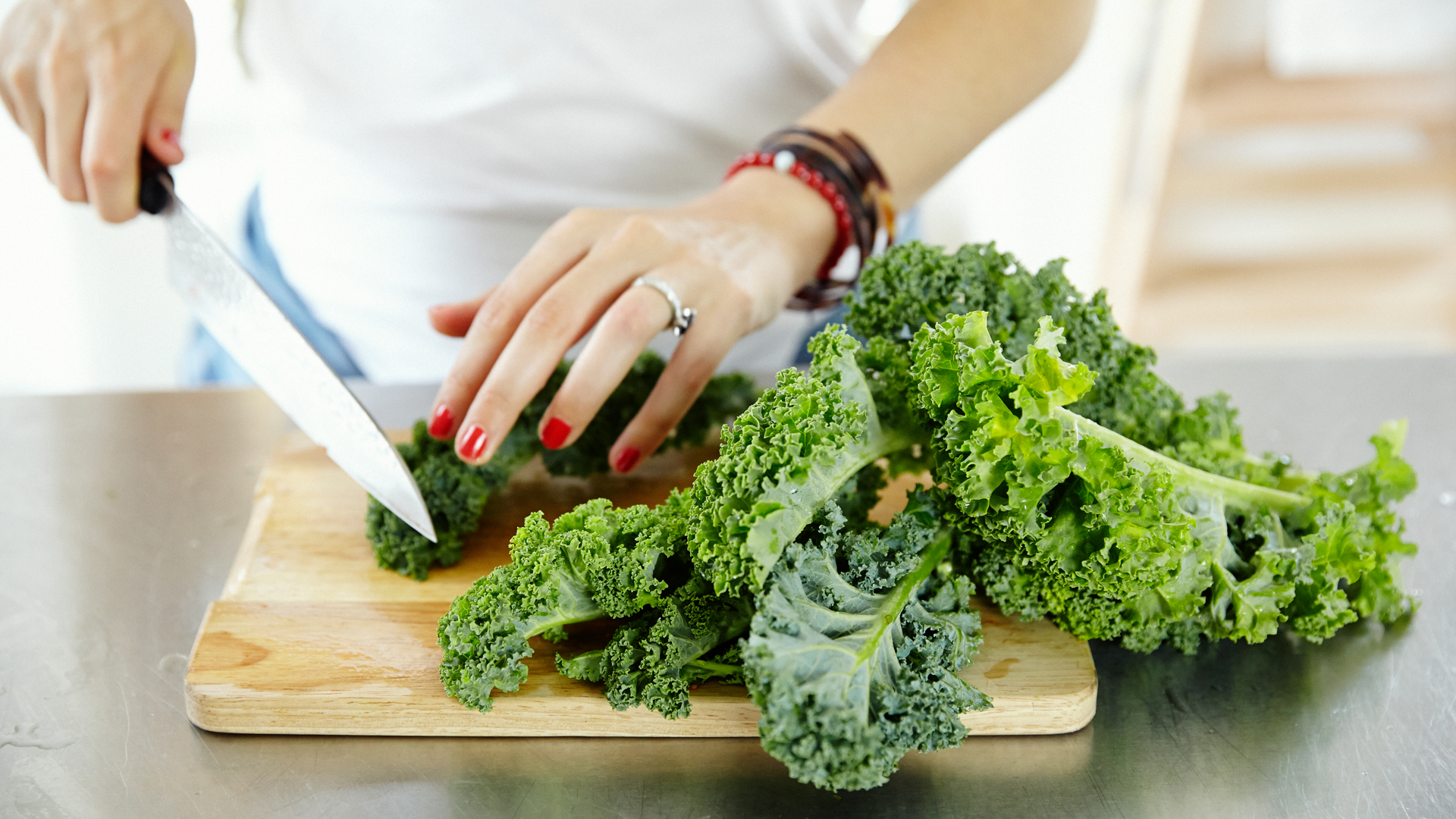 catherine-cuello-chopping-kale-for-her-sweet-potato-kale-and-chives-recipe-foodadit