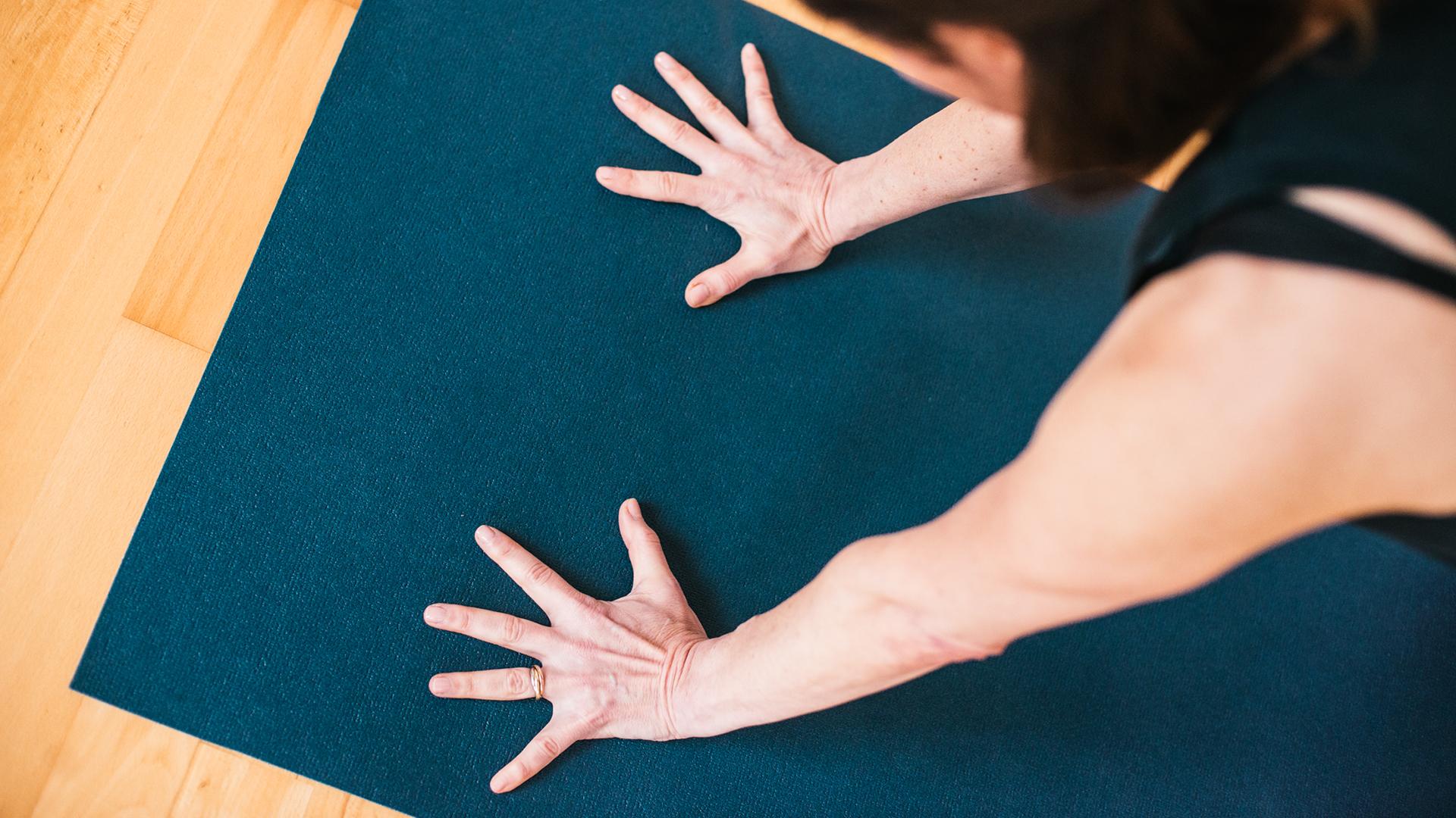 elizabeth-smullens-brass-downward-facing-dog-adho-mukha-svanasana-hands