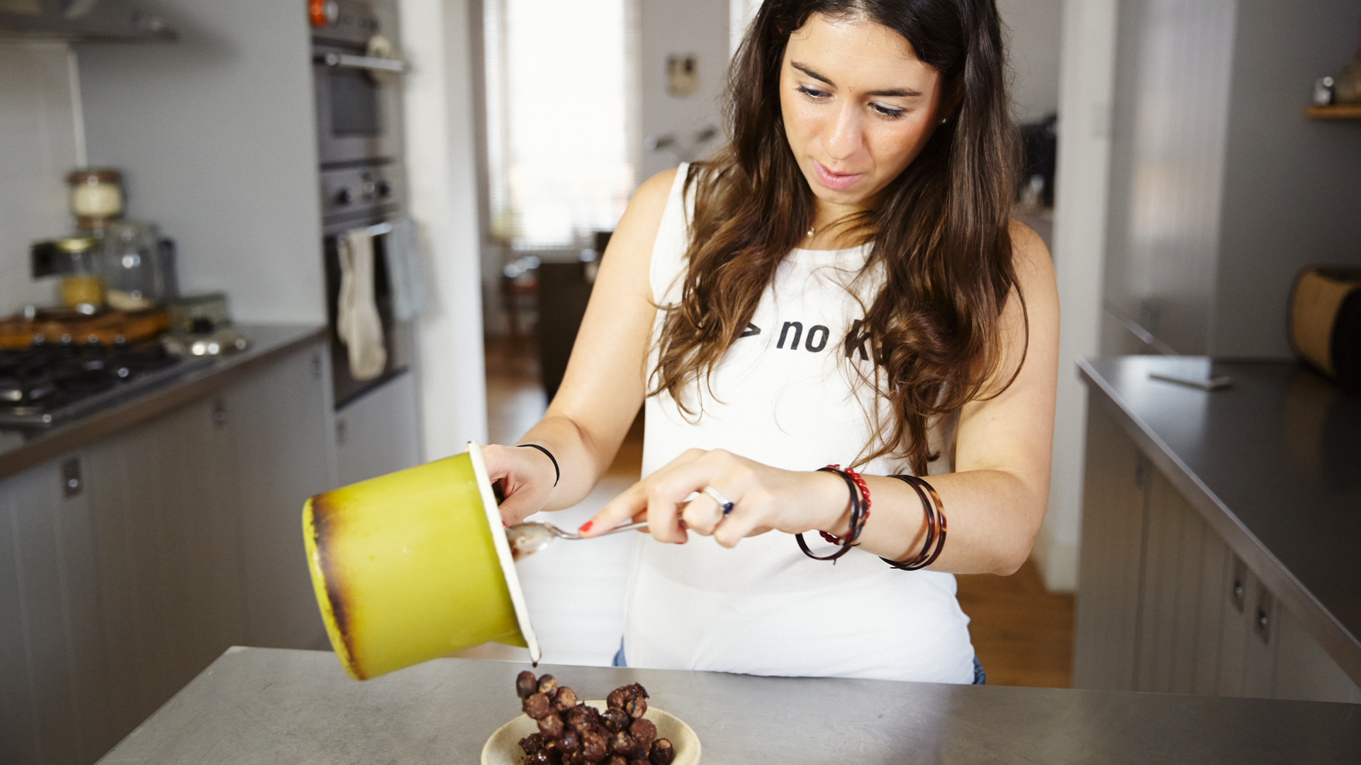 Catherine Cuello-Fuente finishing her Semi-Frozen Blueberries and Raw Cacao recipe