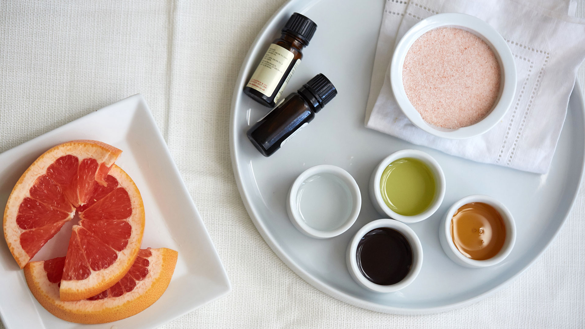 Ingredients for Caroline Wachsmuth's Pink Salt Body Scrub recipe.
