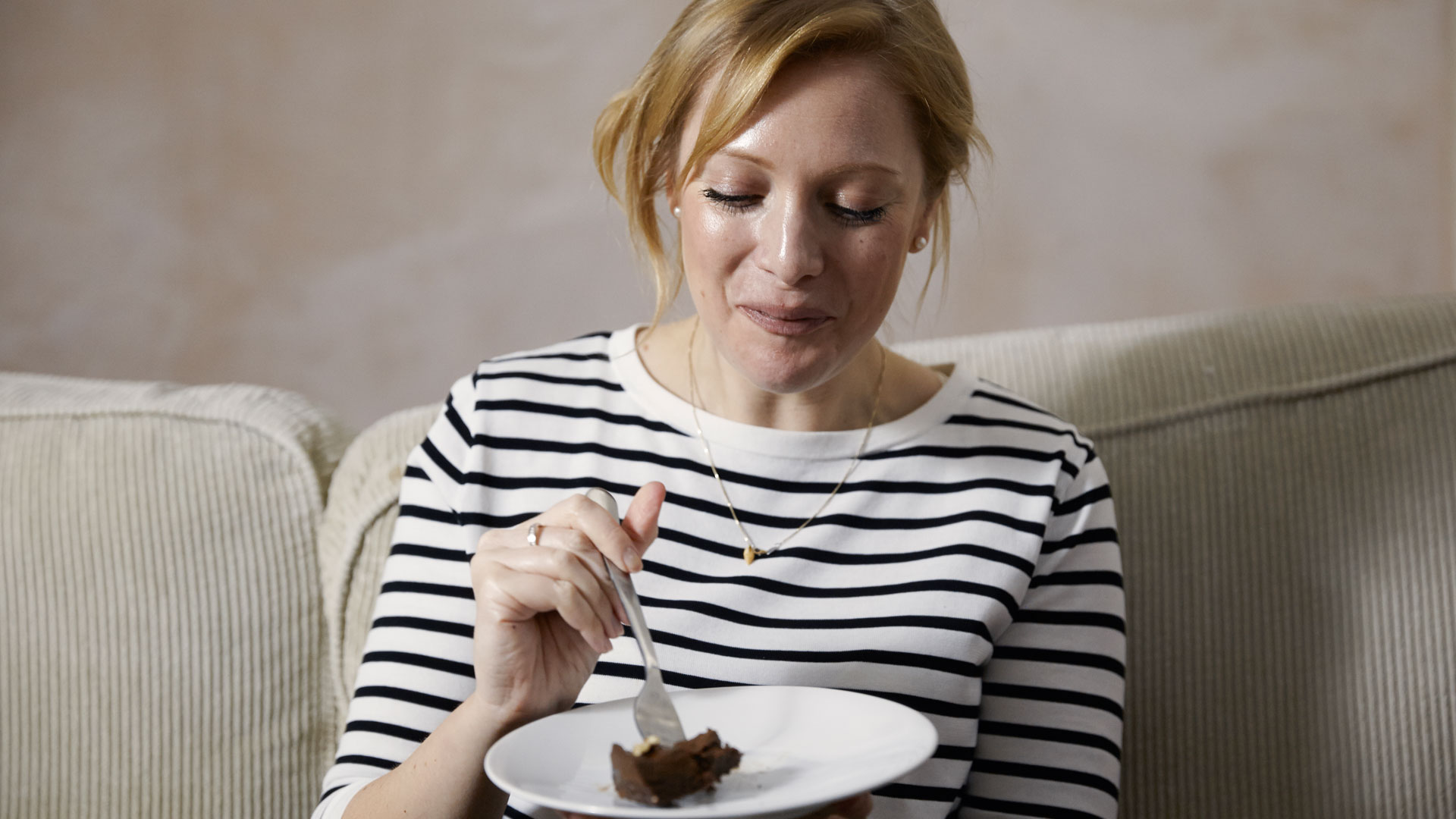 Karen Arkell eating her Chocolate Pecan Tart with Avocado recipe.