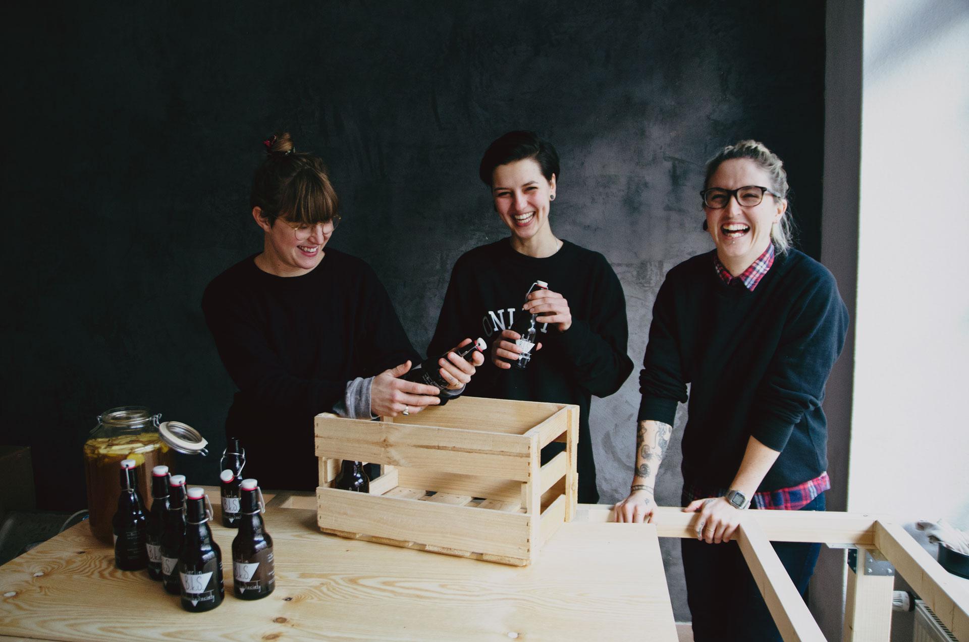 The Berlin Kombucha Society bottling the finished fermented kombucha