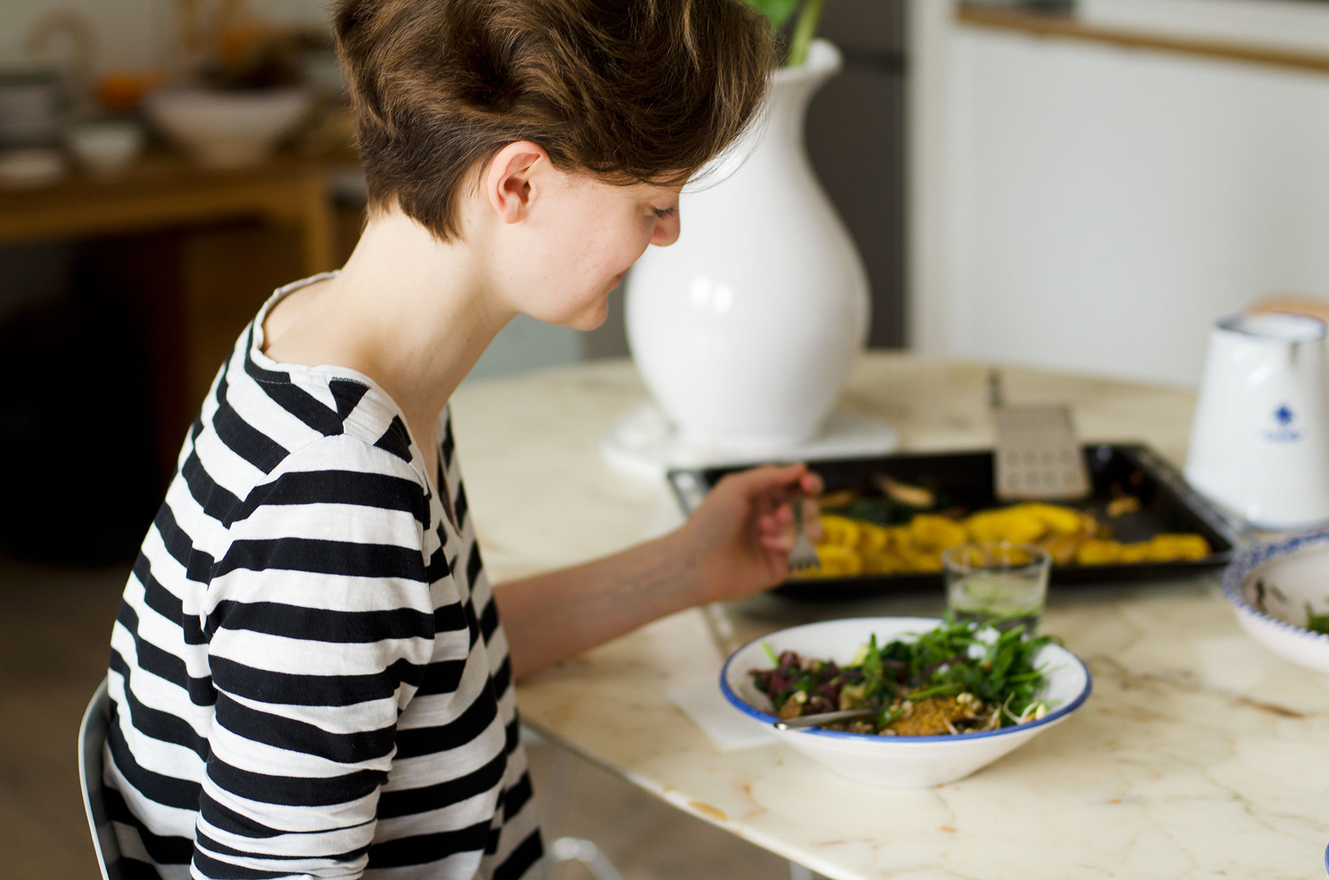 Nele Heinemann enjoying Alanna Lawley's Portobello Booster Bowl recipe for supporting an underactive thyroid.