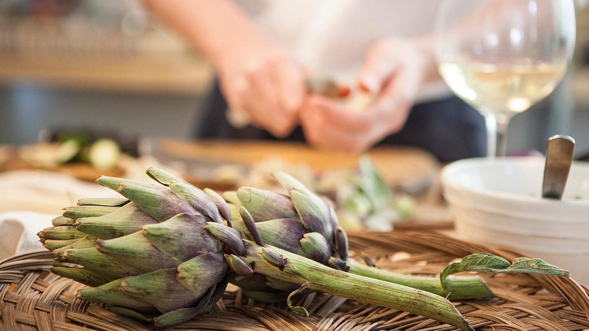Preparing-artichoke-hearts-for-a-salad-in-Greece-Foodadit