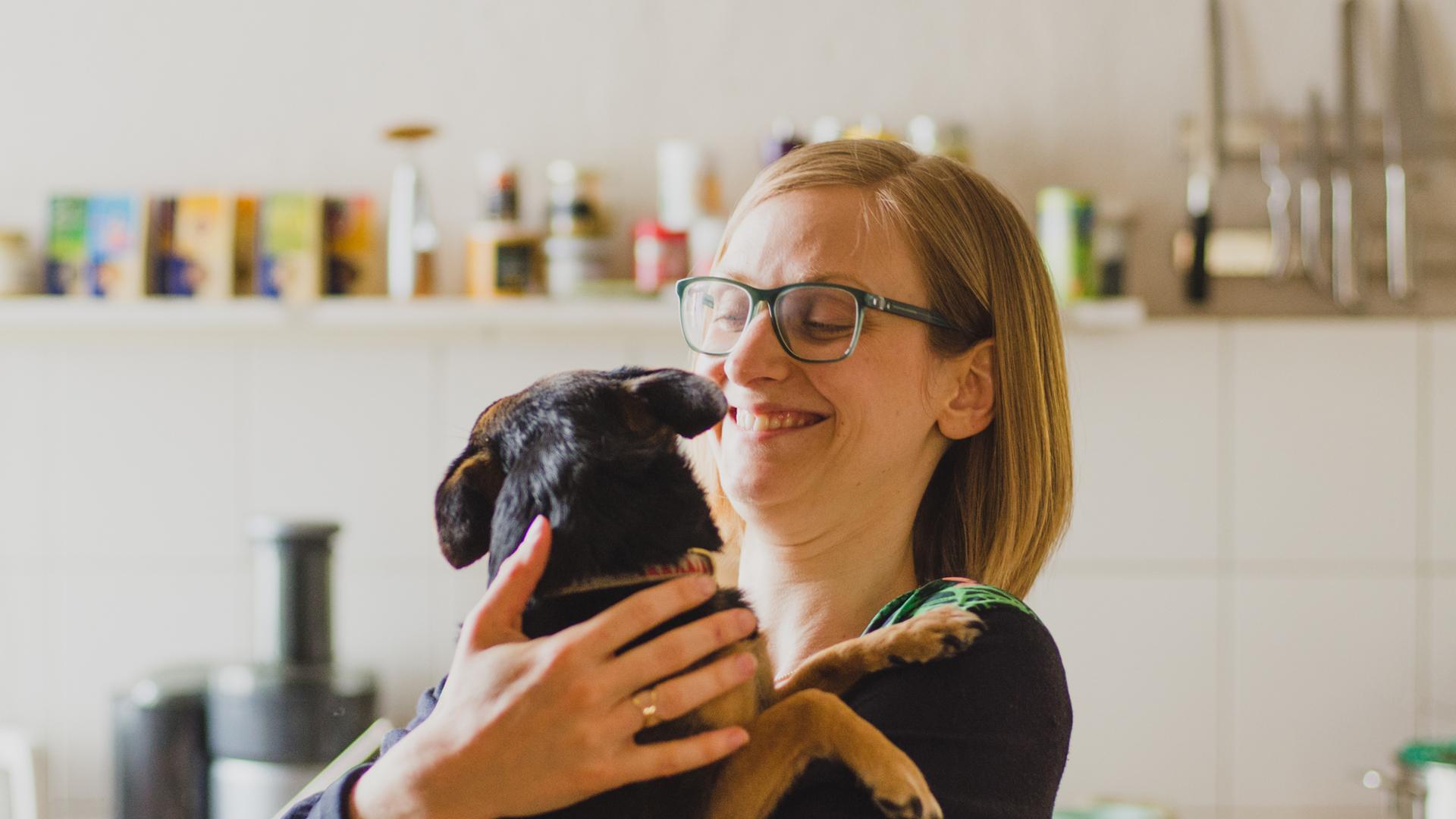 Yoga Teacher, Isabella Paulsen with her dog.